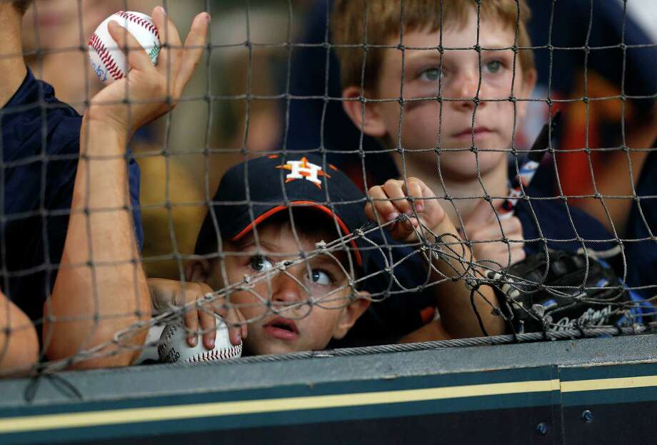 PHOTOS: Browse through the photos to see what the new expanded netting looks like at the Corpus Christi Hooks' Whataburger Field.James Koenig, 4, looks through the netting as he sought player autographs during batting practice before the start of an MLB baseball game at Minute Maid Park, Wednesday, July 6, 2016, in Houston. Photo: Karen Warren, Houston Chronicle / © 2016 Houston Chronicle