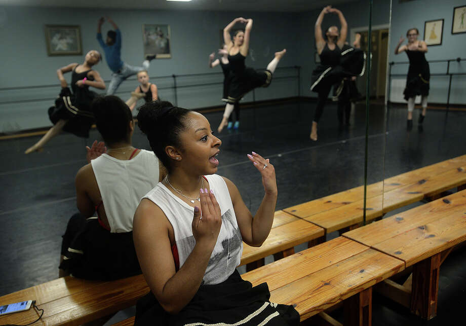 "Charity DeLoera, a former student of Bonnie Cokinos' School of Dance and member of the Beaumont Ballet Theater, leads a class for young dancers at the school while home visiting family Wednesday. DeLoera, who started dancing at the age of three, went on to study dance at Fordham University in New York City and the American Dance Theater under Alvin Aley. She has since appeared in shows on Broadway, including a run with ""The Lion King."" Wednesday, she taught students a segment from the Broadway production of ""West Side Story,"" offering tips on auditions and sharing her experiences in the world of professional dance. DeLoera also teaches dance, and will be traveling to Beijing for a month-long dance theater workshop. While home in Beaumont, she has made a point to visit some of her favorite spots, including Jason's Deli and Casa Ole. Photo taken Wednesday, July 6, 2016 Kim Brent/The Enterprise Photo: Kim Brent / Beaumont Enterprise"