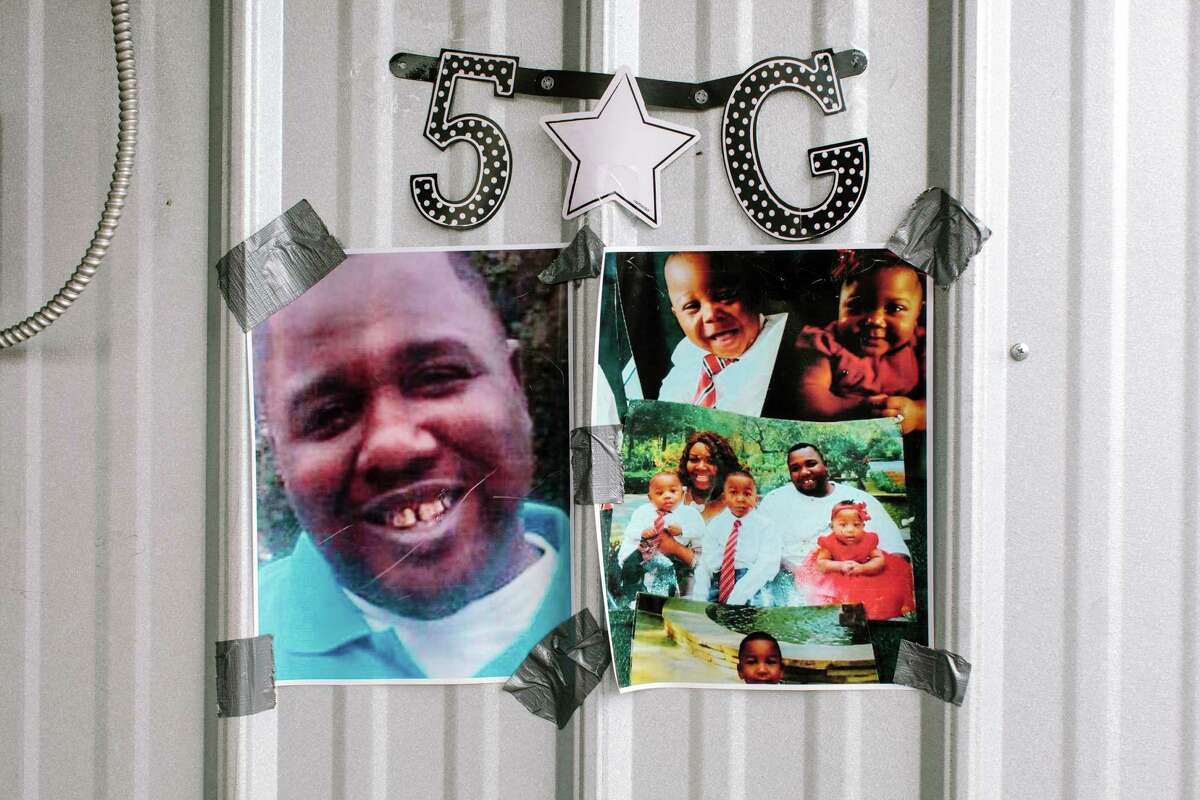 Photos of Alton Sterling and his family are displayed at the Baton Rouge store Wednesday.
