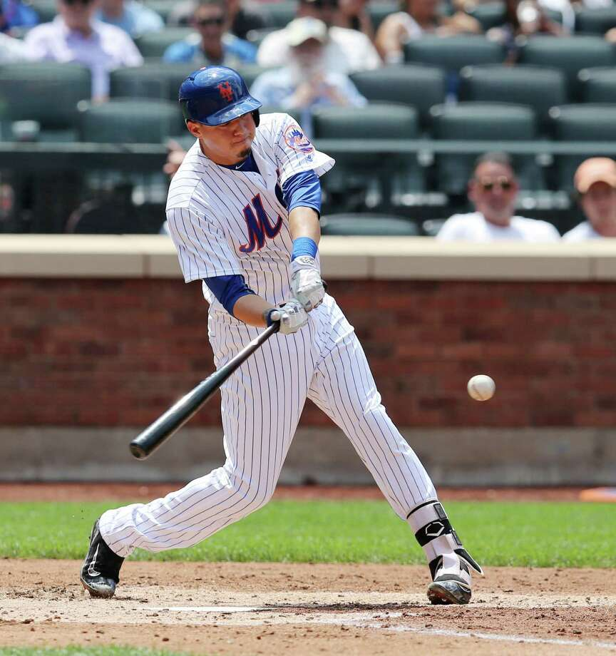 New York Mets' Wilmer Flores hits his second home run during the fourth inning of the baseball game against the Miami Marlins at Citi Field, Wednesday, July 6, 2016 in New York. (AP Photo/Seth Wenig) ORG XMIT: NYSW109 Photo: Seth Wenig / Copyright 2016 The Associated Press. All rights reserved. This m