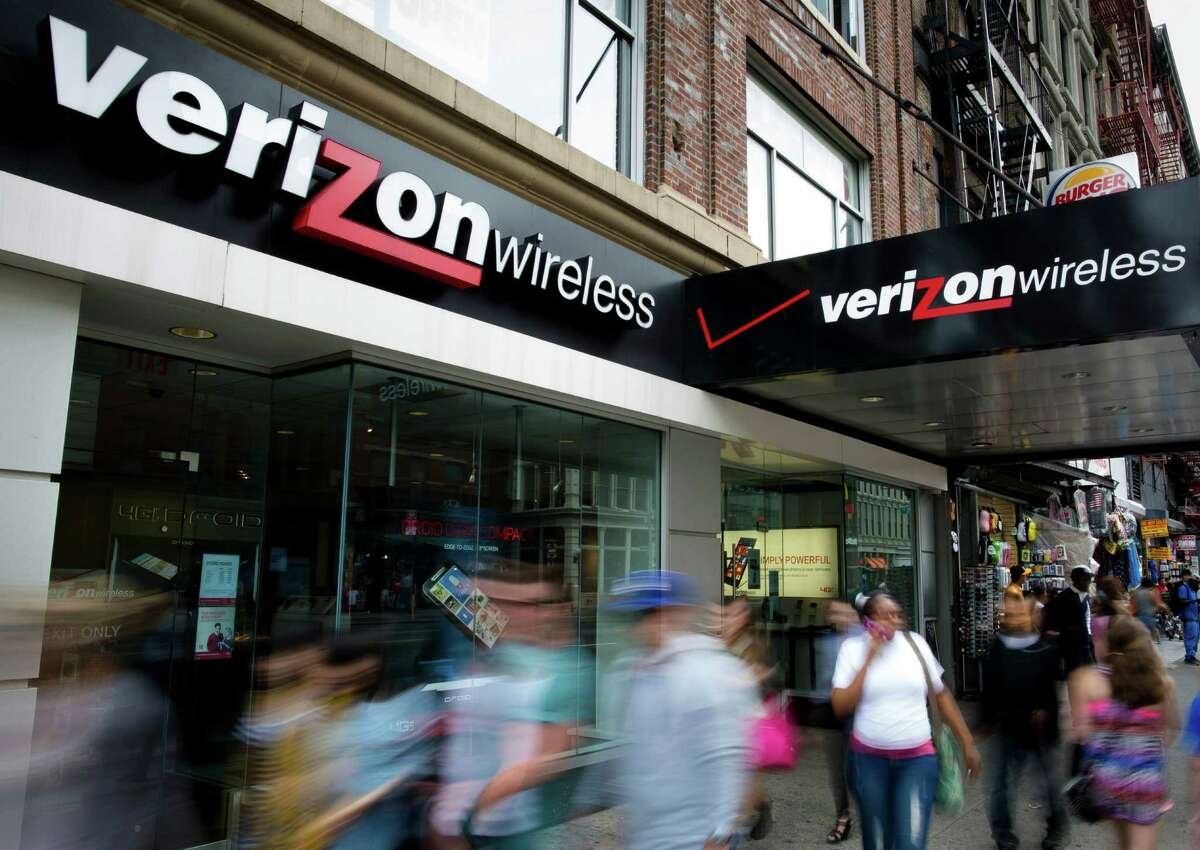In this June 6, 2013, file photo, pedestrians pass a Verizon Wireless store on Canal Street in New York. Verizon announced Tuesday, July 24, 2018, that the company will unveil 5G technology in Houston.