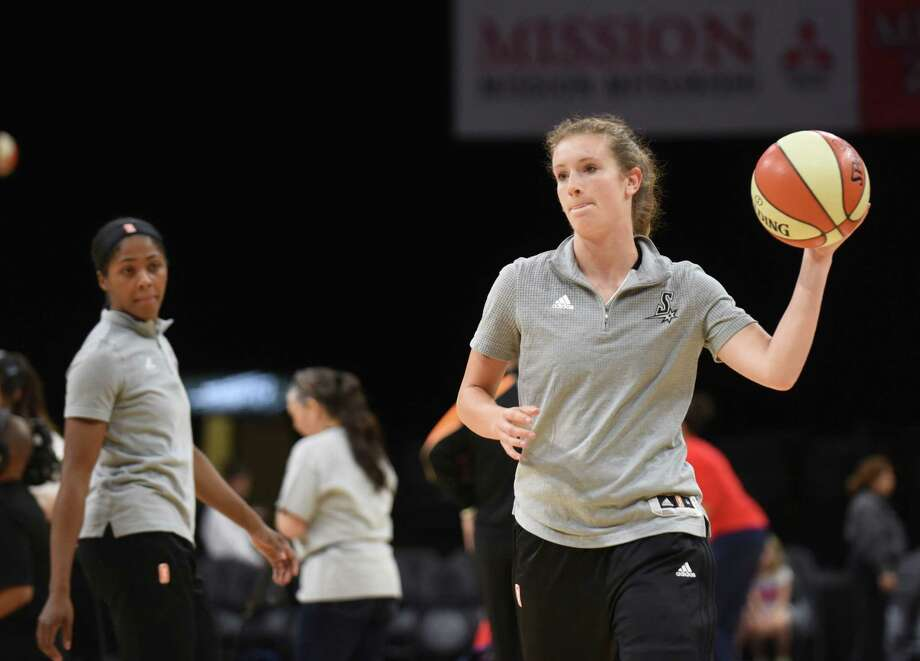 Blake Dietrick of the San Antonio Stars warms up with teammates before their WNBA game against the Washington Mystics in the AT&T Center on Wednesday, July 6, 2016. Photo: Billy Calzada, Staff / San Antonio Express-News / San Antonio Express-News