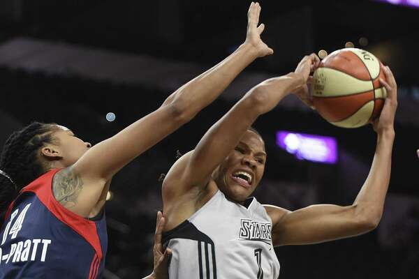 Monique Currie of the San Antonio Stars come down with a rebound against Washington's Tierra Ruffin-Pratt during WNBA action in the AT&T Center on Wednesday, July 6, 2016.