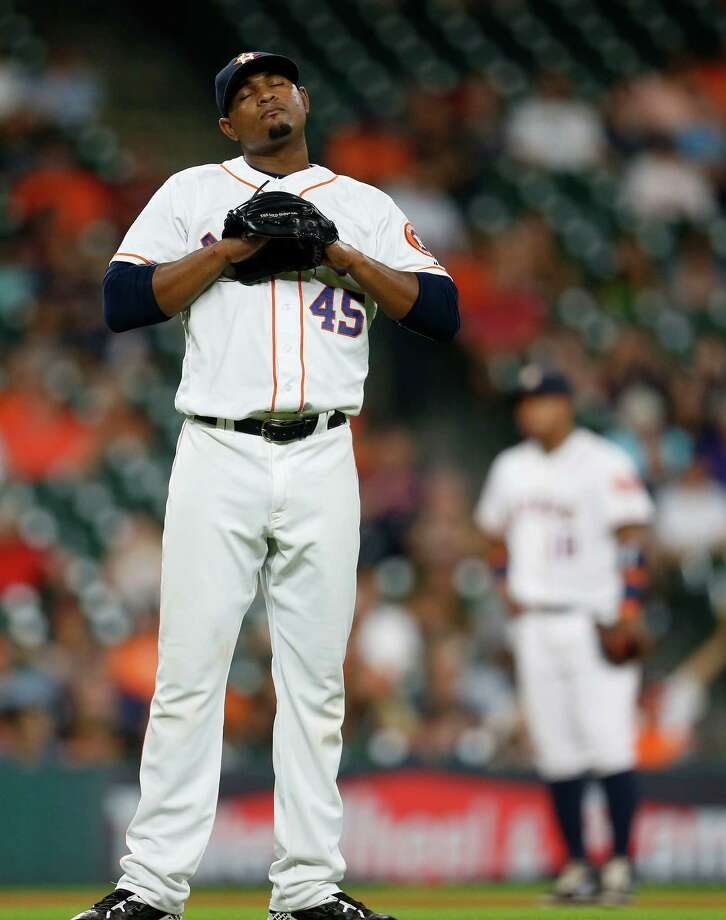 Houston Astros relief pitcher Michael Feliz (45) reacts after giving up a game-tying, three-run home run to Seattle Mariners Seth Smith during the seventh inning of an MLB baseball game at Minute Maid Park, Wednesday, July 6, 2016, in Houston. ( Karen Warren  / Houston Chronicle ) Photo: Karen Warren, Staff / © 2016 Houston Chronicle