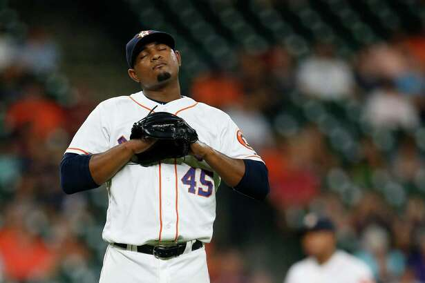 Houston Astros relief pitcher Michael Feliz (45) reacts after giving up a game-tying, three-run home run to Seattle Mariners Seth Smith during the seventh inning of an MLB baseball game at Minute Maid Park, Wednesday, July 6, 2016, in Houston. ( Karen Warren  / Houston Chronicle )