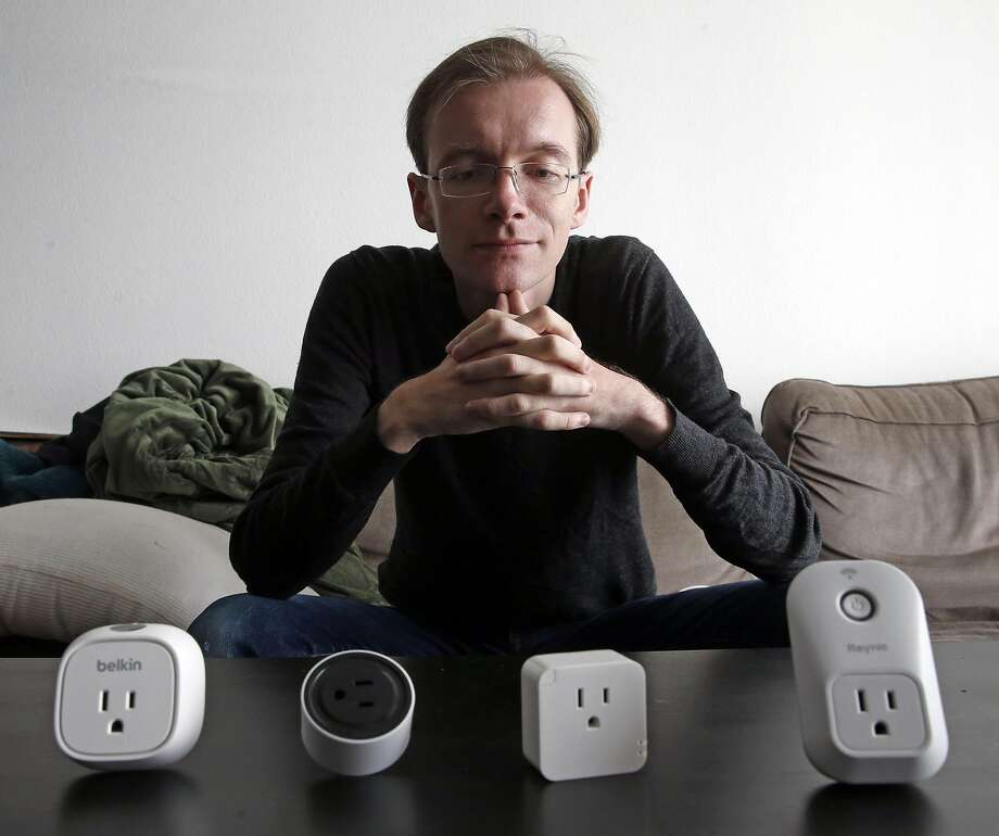 Matthew Garrett, a security developer who studies Internet-controlled outlets, with some devices he has tested. Photo: Scott Strazzante, The Chronicle