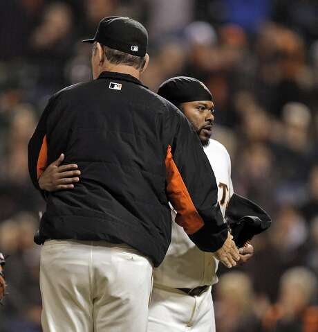 Johnny Cueto (47) gets a hug from manager Bruce Bochy after Cueto pitched a one-run complete game as the San Francisco Giants played the Colorado Rockies at AT&T Park in San Francisco, Calif., on Wednesday, July 6, 2016. Photo: Carlos Avila Gonzalez, The Chronicle