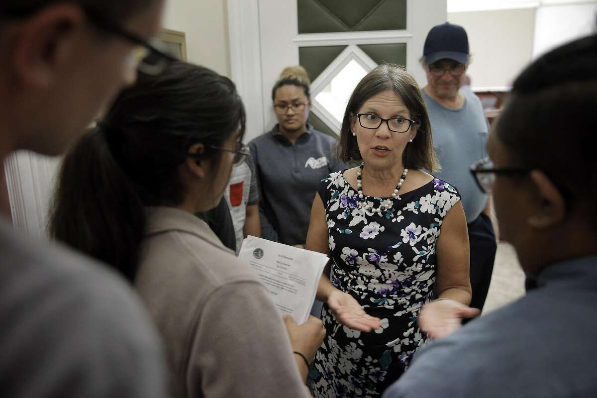 Alameda Mayor Trish Herrera Spencer discusses changes to the agenda order with students outside the council chambers as the Alameda City Council discussed three rent control measures to go before the voters at Alameda City Hall in Alameda, Calif., on Tuesday, July 5, 2016. The students had requested that the rent control measures be moved up in the agenda since many people would not be able to stay and comment if the measures were left at the end. Herrera Spencer stated she would bring the change up with the council after the recess.