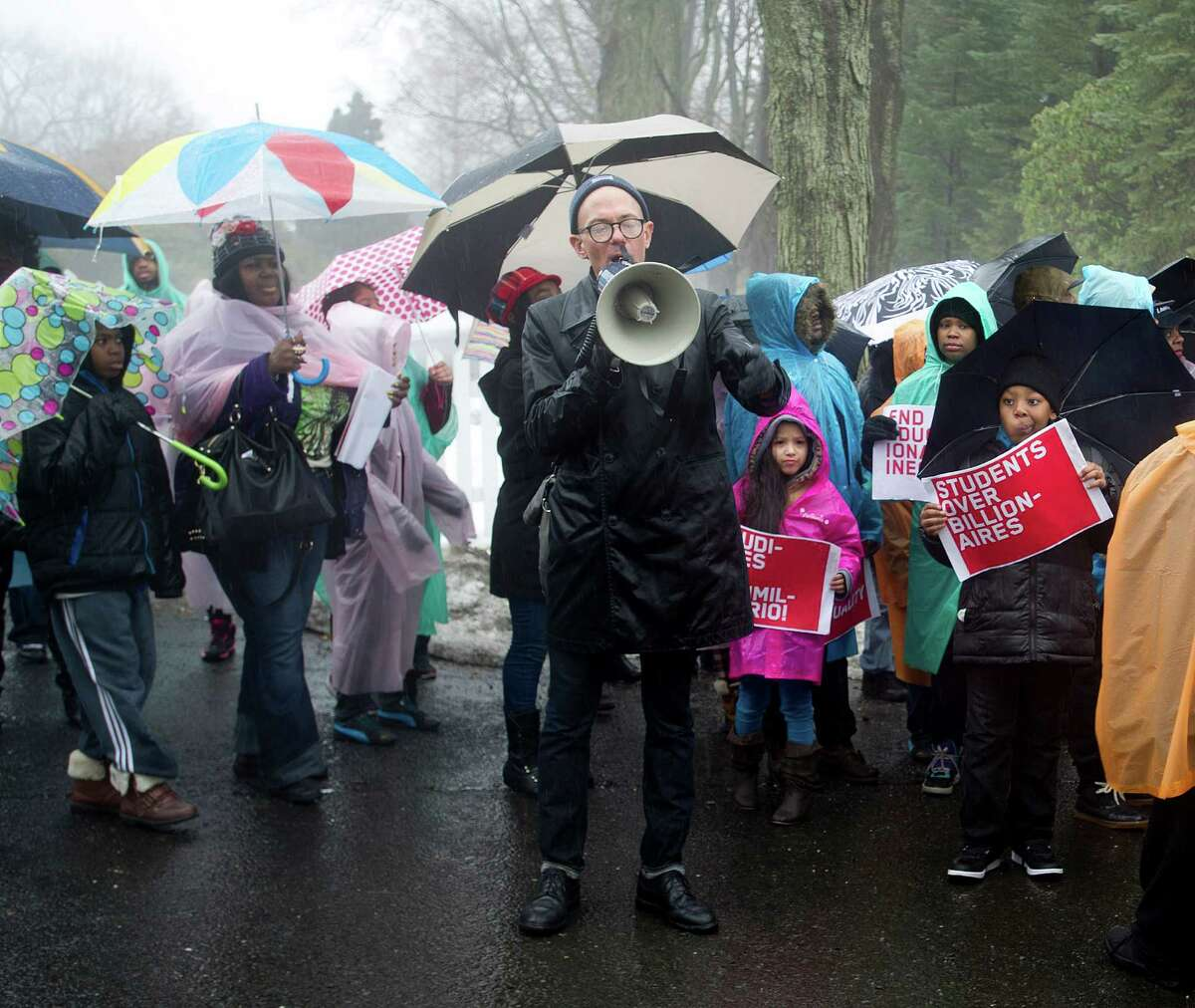 Marchers in Greenwich braved the rain during a March, 2015 protest against hedge fund manager Paul Tudor Jones' funding of Republican politicians opposed to higher minimum wages.