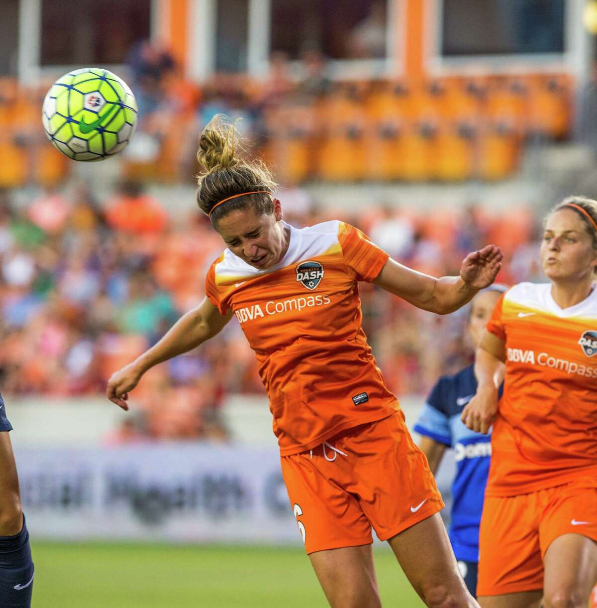 Houston Dash midfielder Morgan Brian (6) head butts the ball away from FC Kansas City defender Brittany Taylor (13) from scoring during the first half of action between the Houston Dash and the FC Kansas City during a soccer game at BBVA Compass, Sunday, June 19, 2016, in Houston.
