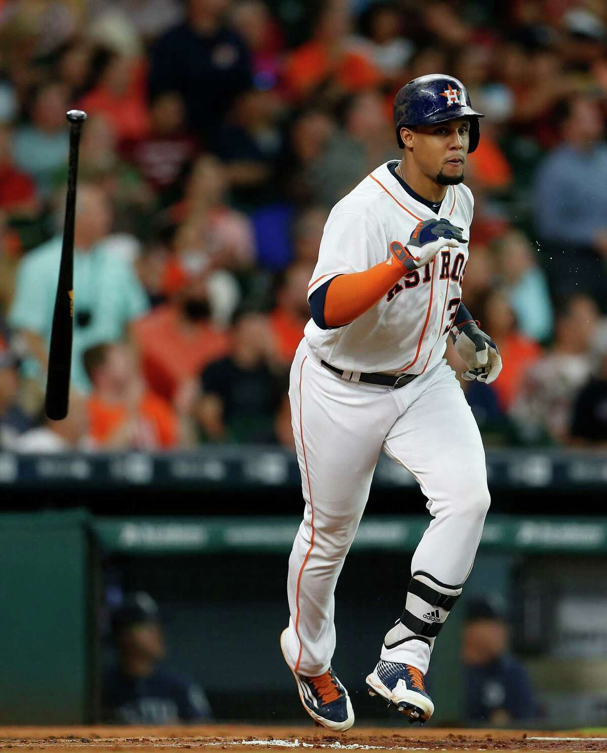 Houston Astros center fielder Carlos Gomez (30) flips his bat after hitting his RBI double during the first inning of an MLB baseball game at Minute Maid Park, Wednesday, July 6, 2016, in Houston. ( Karen Warren / Houston Chronicle )