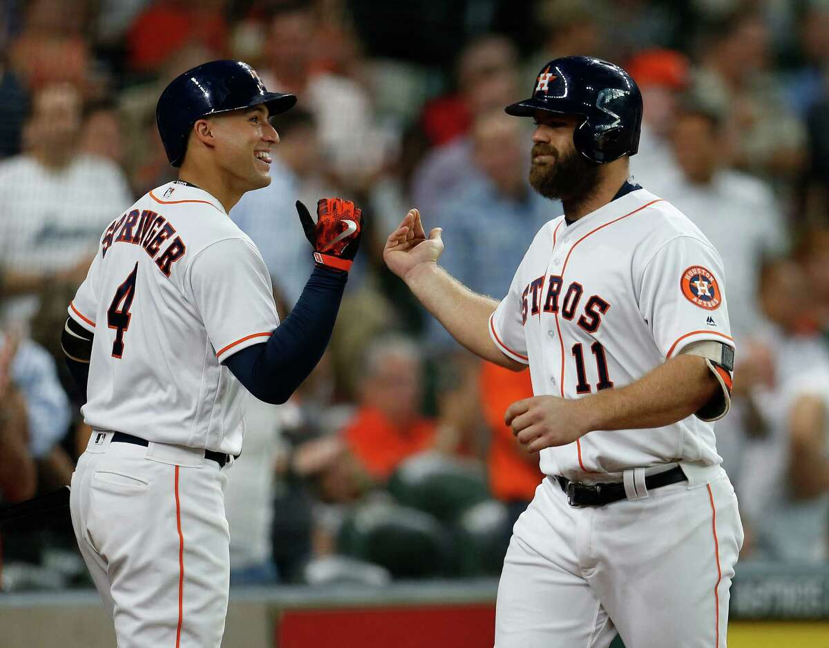 Houston Astros designated hitter Evan Gattis (11) celebrates his home run with George Springer (4) during the second inning of an MLB baseball game at Minute Maid Park, Wednesday, July 6, 2016, in Houston. ( Karen Warren / Houston Chronicle )