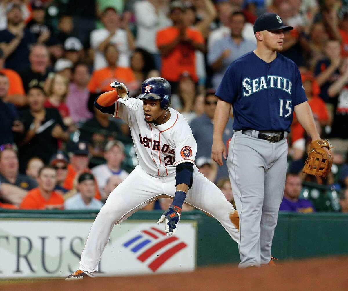 Houston Astros center fielder Carlos Gomez (30) reacts after reaching third base on his RBI triple during the third inning of an MLB baseball game at Minute Maid Park, Wednesday, July 6, 2016, in Houston. ( Karen Warren / Houston Chronicle )