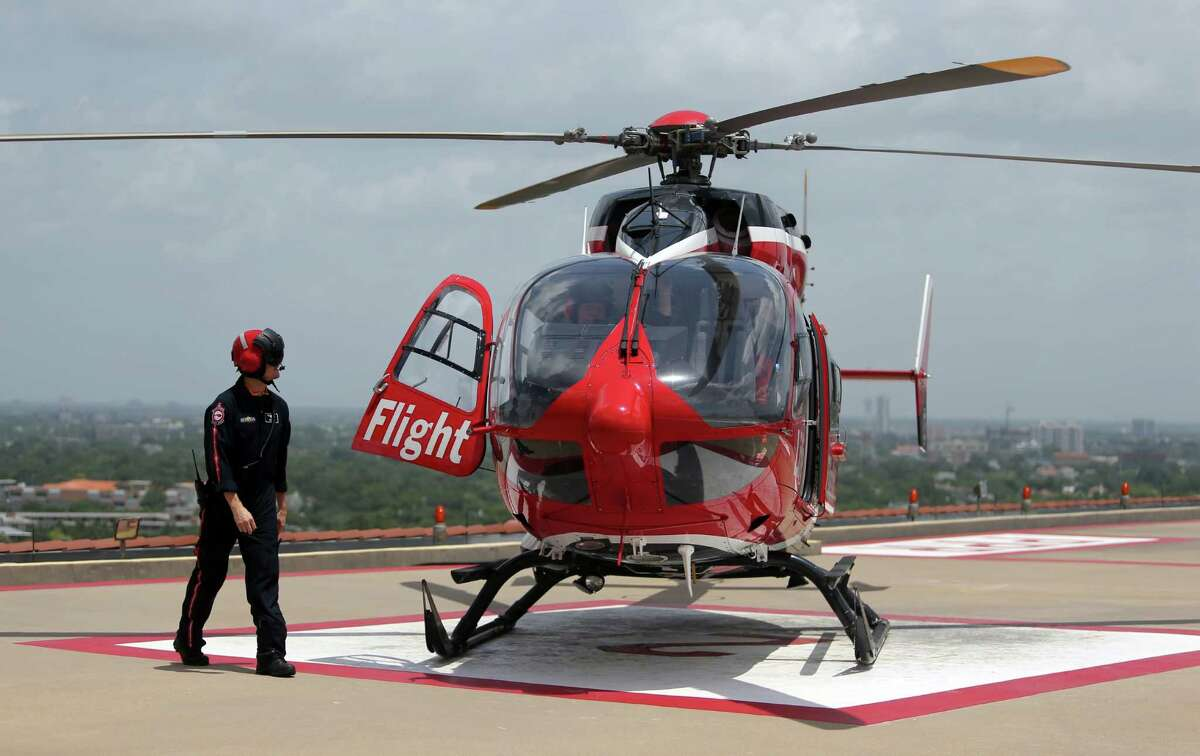 Flight Nurse Chris Oliver prepared to board a LifeFlight helicopter. To upgrade its trauma care, The Woodlands hospital is adding a second helipad and an additional 3,400 square feet of treatment and trauma rooms to its emergency center. The renovations are ongoing and are expected to be complete by next March.