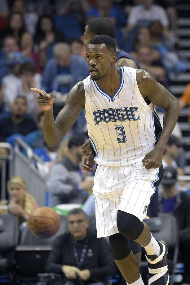 Orlando Magic center Dewayne Dedmon (3) acknowledges a teammate after scoring during the first half of an NBA basketball game against the Memphis Grizzlies in Orlando, Fla., Sunday, April 3, 2016. (AP Photo/Phelan M. Ebenhack) Photo: Phelan M. Ebenhack, AP