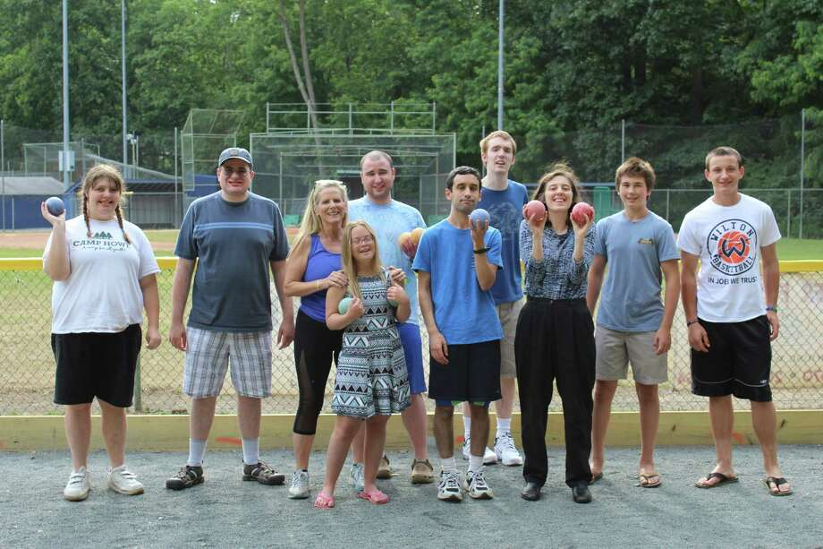 The Roaring Twenties group played Bocce on Sunday, July 3, at the Wilton Family YMCA. (From left to right) Maddie Hess, Thomas Belmont, Christina Foley (YMCA director of special needs), Alexandra Santopietro, Michael Shukovsky, Ritt Fortier, Nick Walsh, Angela Caputo, Alex Sywak (YMCA volunteer) and Ryan Schriber (YMCA volunteer). Photo: Stephanie Kim / Hearst Connecticut Media