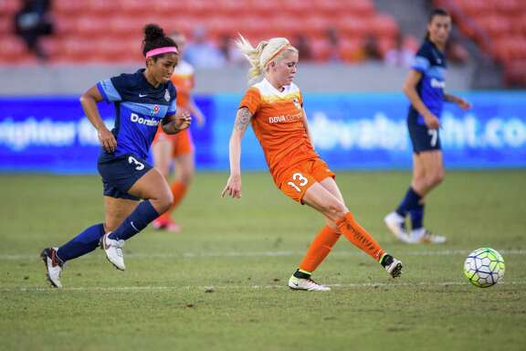 Houston Dash midfielder Denise O'Sullivan (13) kicks the ball away from FC Kansas City midfielder Desiree Scott (3) during the first half of action between the Houston Dash and the FC Kansas City during a soccer game at BBVA Compass, Sunday, June 19, 2016, in Houston.