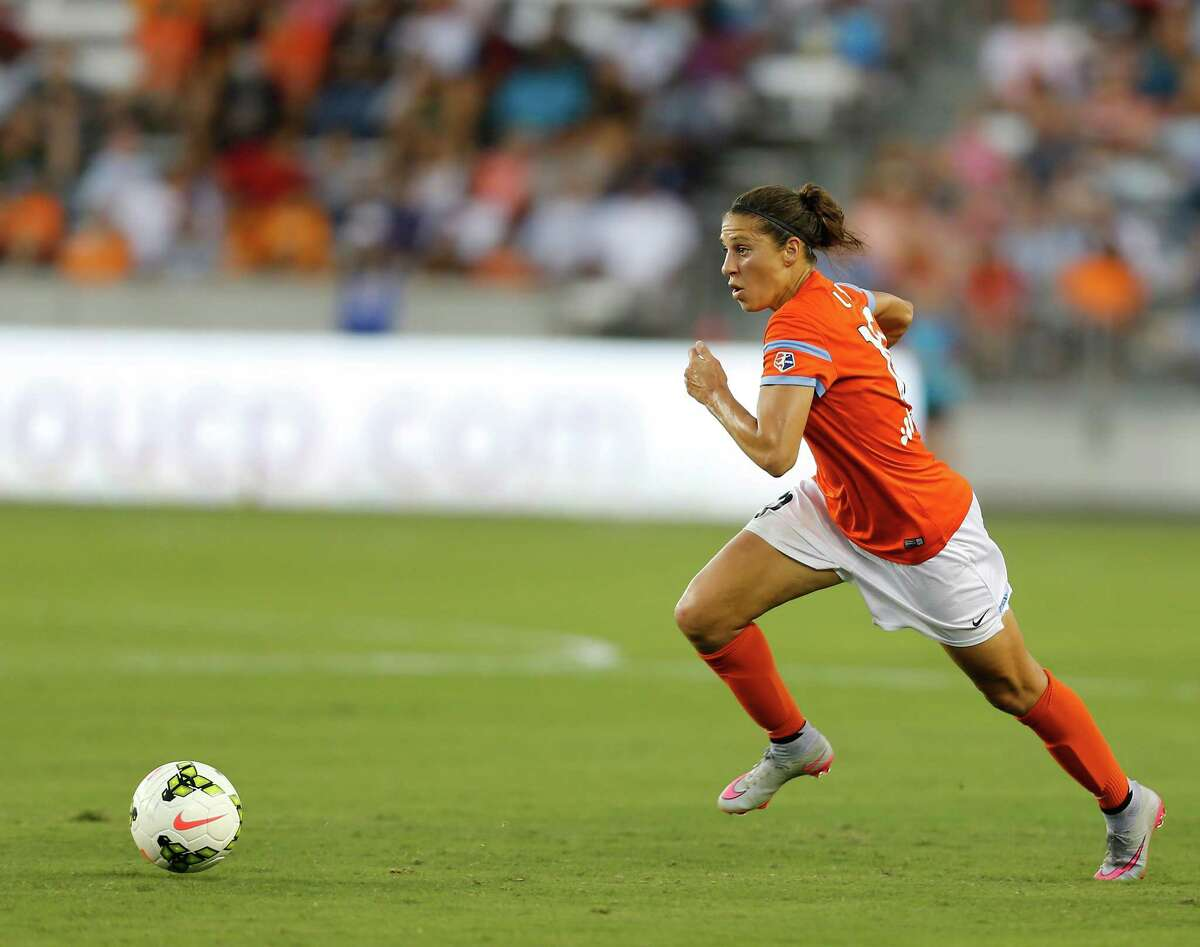 Houston Dash midfielder Carli Lloyd chases the ball during the first half of National Women's Soccer League game action at BBVA Compass Stadium Friday, Aug. 7, 2015, in Houston.