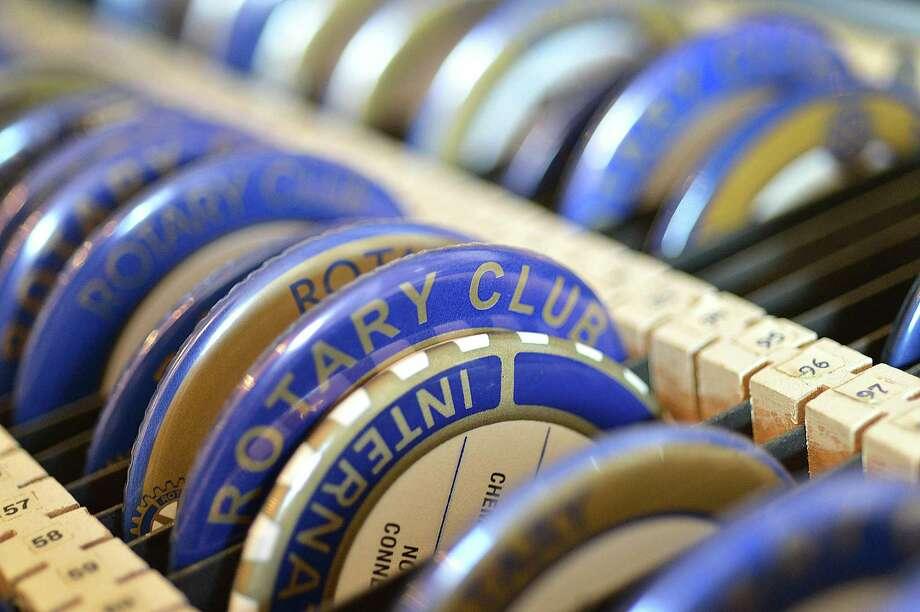 Norwalk Rotary Club badges organized in a case for members. Photo: Alex Von Kleydorff / Hearst Connecticut Media