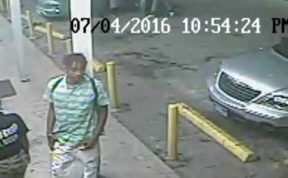 Police are searching for a man who was caught on camera at the scene of a shooting on the East Side on the Fourth of July. Photo: San Antonio Police Department