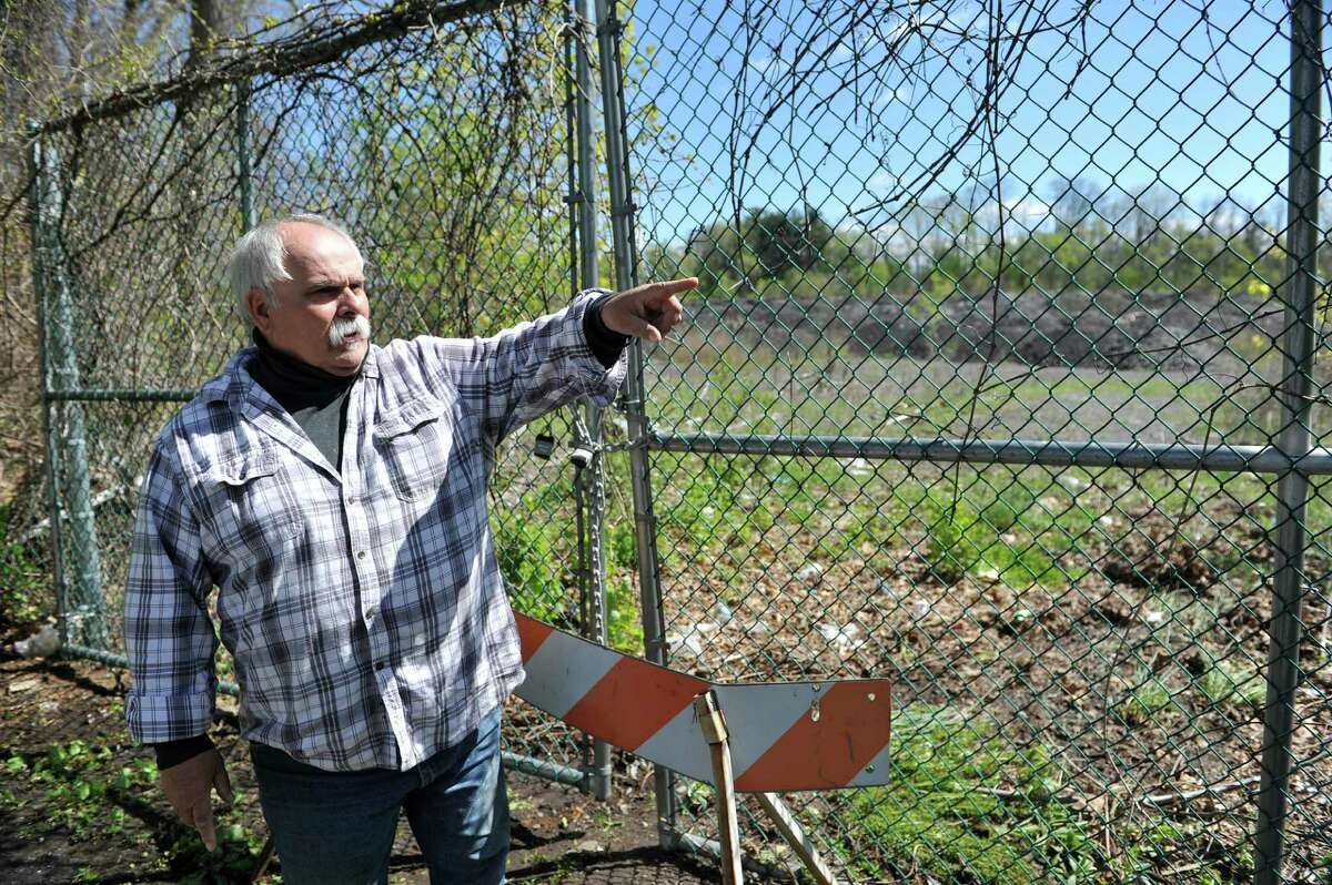 Marc Della Villa stands near a gate that leads into the Cheltingham landfill on Monday, May 9, 2016, in Schenectady, N.Y. Della Villa said his crusade against the city landfill has nothing to do with the state going after him for his own landfill, which was much smaller than the Cheltingham site. (Paul Buckowski / Times Union)