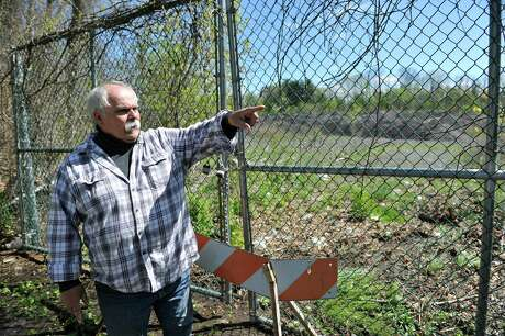 Marc Della Villa stands near a gate that leads into the Cheltingham landfill on Monday, May 9, 2016, in Schenectady, N.Y.  Della Villa said his crusade against the city landfill has nothing to do with the state going after him for his own landfill, which was much smaller than the Cheltingham site.  (Paul Buckowski / Times Union) Photo: PAUL BUCKOWSKI / 20036442A