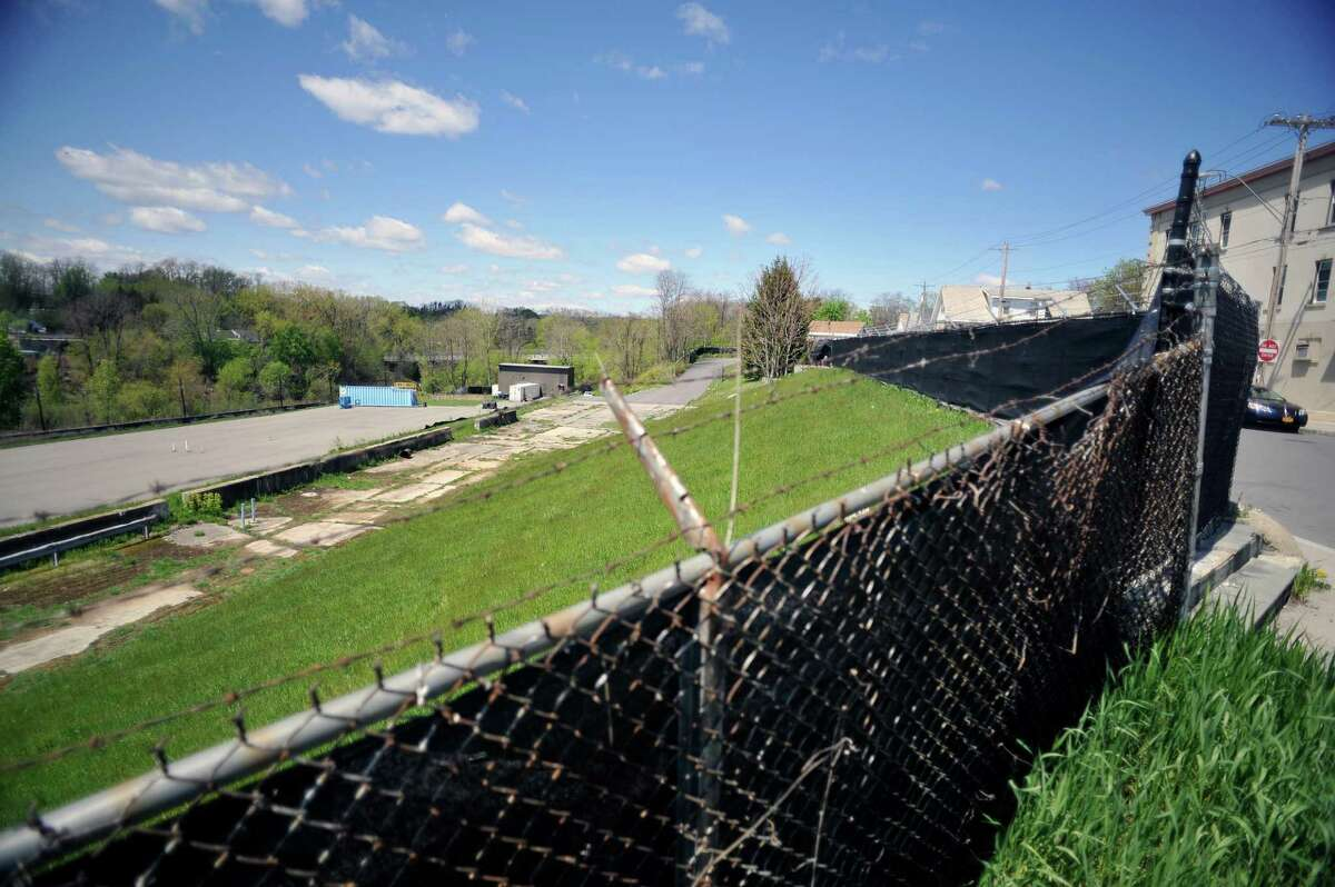 A view of the site of the former Schenectady International plant along 10th Ave., seen here on Monday, May 9, 2016, in Schenectady, N.Y. A groundwater treatment system was put in in 2002 to stop contaminants from entering a creek, and then the buildings were demolished. (Paul Buckowski / Times Union)