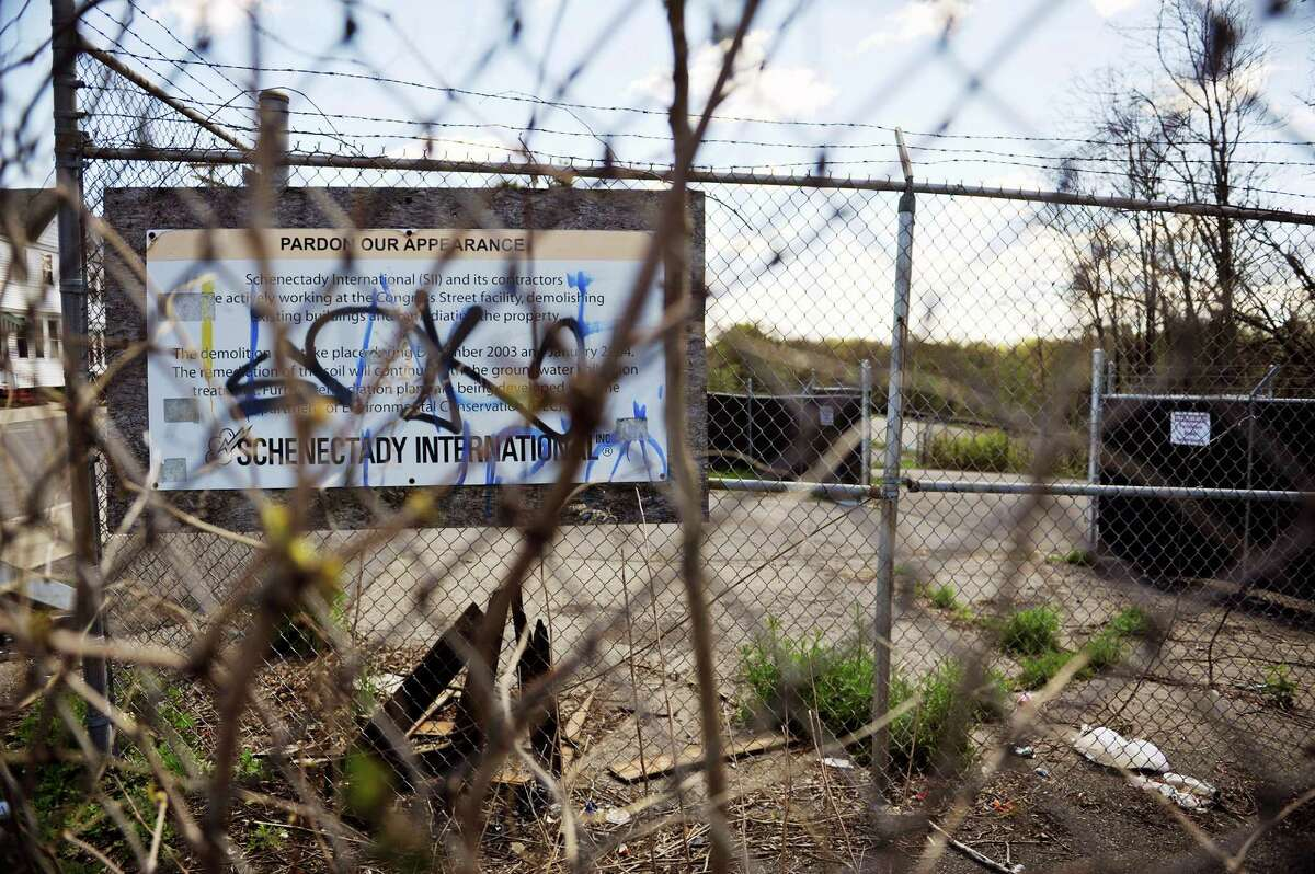 A view of the site of the former Schenectady International plant along 10th Ave., seen here on Monday, May 9, 2016, in Schenectady, N.Y. The vandalized and outdated sign was removed a week later after the Times Union contacted the company. (Paul Buckowski / Times Union)
