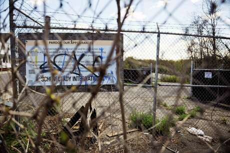 A view of the site of the former Schenectady International plant along 10th Ave., seen here on Monday, May 9, 2016, in Schenectady, N.Y. The vandalized and outdated sign was removed a week later after the Times Union contacted the company.   (Paul Buckowski / Times Union) Photo: PAUL BUCKOWSKI / 20036442A