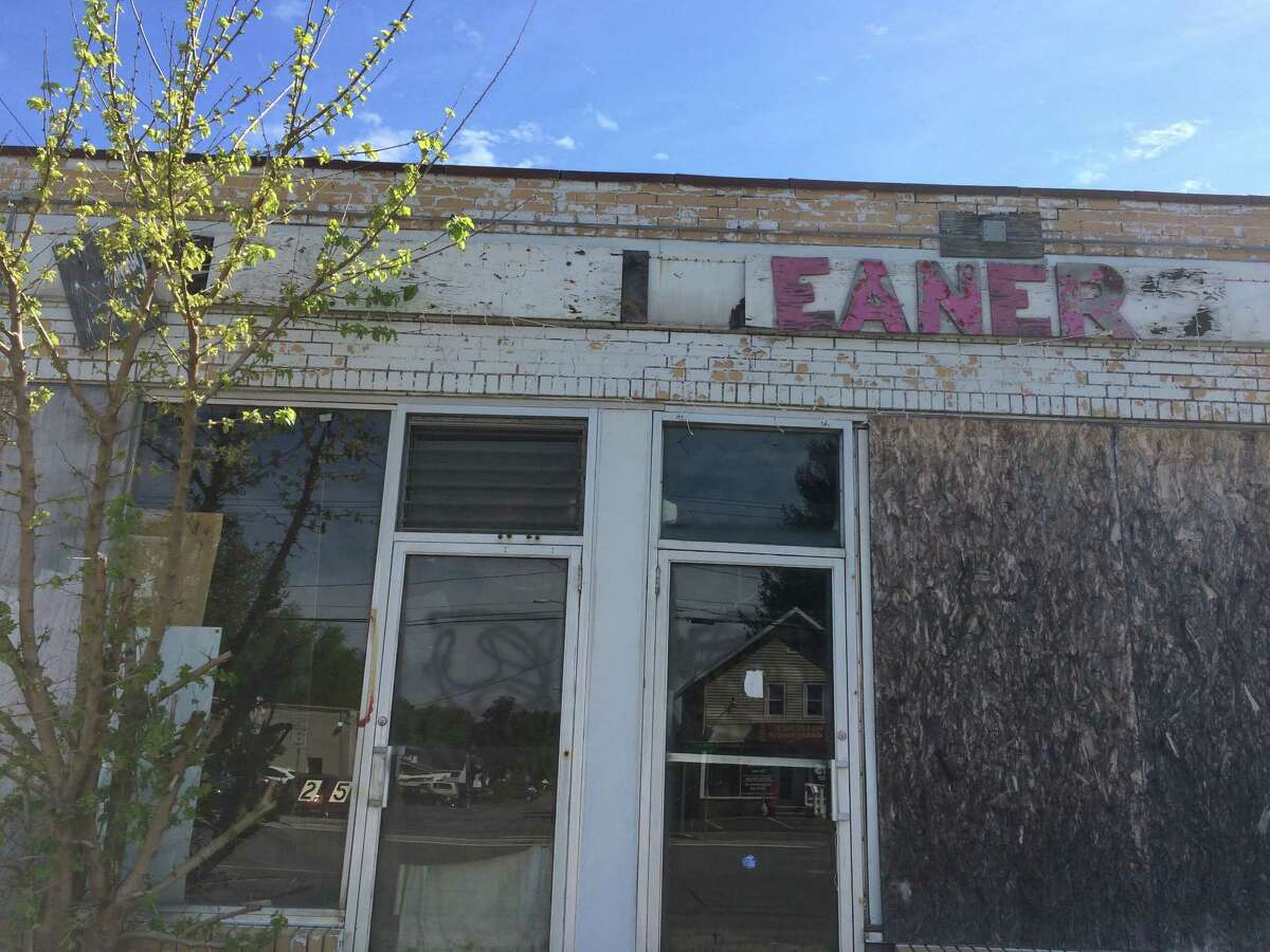 The former Damshire Cleaners, 1205 Central Ave. The state fined its former owner for cleanup costs 15 years ago, but full remediation of the site has still not happened. (Lauren Stanforth)