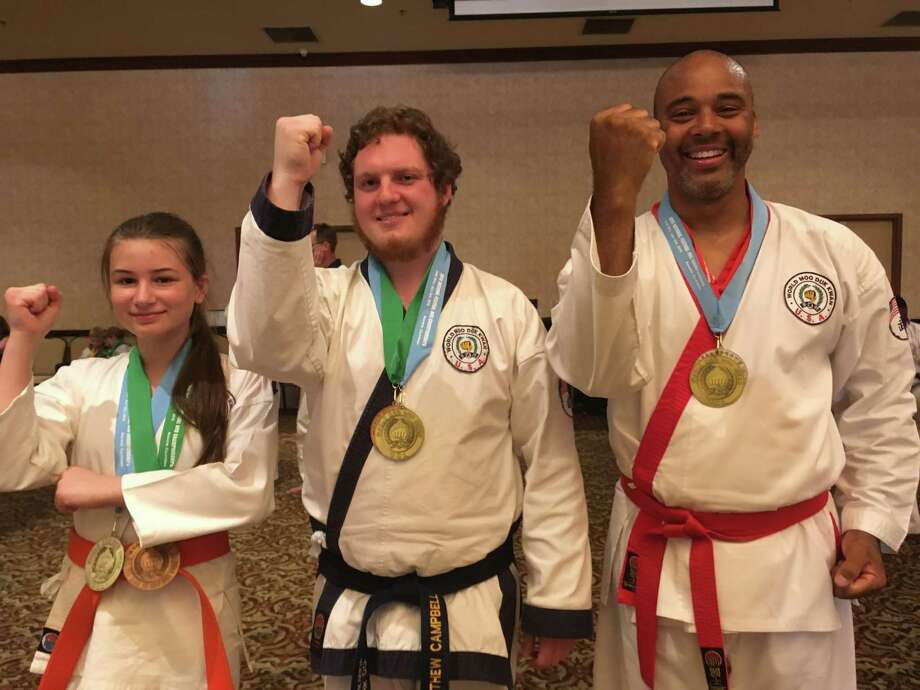 Soo Bahk Do gold medalists display their winnings at the national championships in Anaheim, California. From left-to-right: Sadie Kinnersley, Matt Campbell, and Michael Gordon. Photo: Contributed Photo