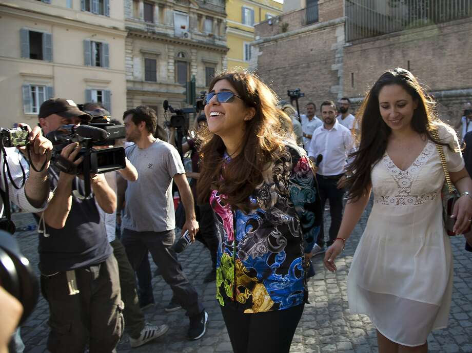 Communications expert Francesca Chaouqui (center) received a 10-month suspended sentence. Photo: Domenico Stinellis, Associated Press