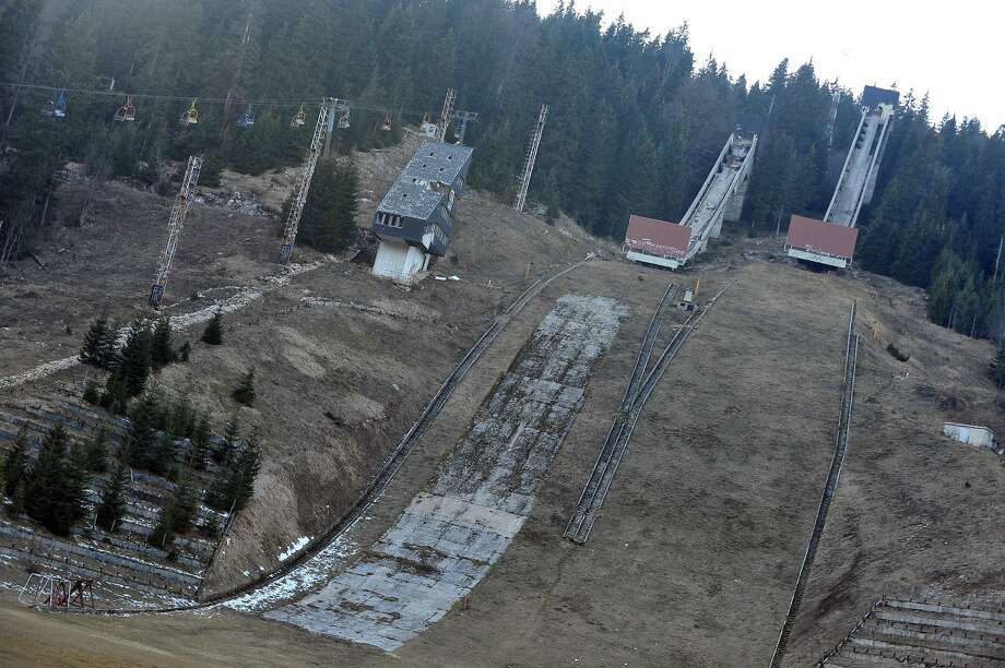 A picture taken on February 5, 2014 shows Sarajevo's abandoned ski jumping venue at Mt. Igman near Sarajevo. Built and used as an Olympic venue during Sarajevo's 1984 Winter Olympic Games, the ramps were heavily damaged during Bosnia's 1992-95 war. They were never rebuilt and it's large concrete structure remains standing as a memento of past. Photo: ELVIS BARUKCIC/AFP/Getty Images