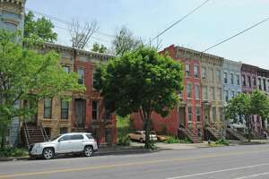 195 Clinton Avenue, left, scene of the 1997 murder of UAlbany student Erik Mitchell on Thursday May 26, 2016 in Albany, N.Y. (Michael P. Farrell/Times Union)