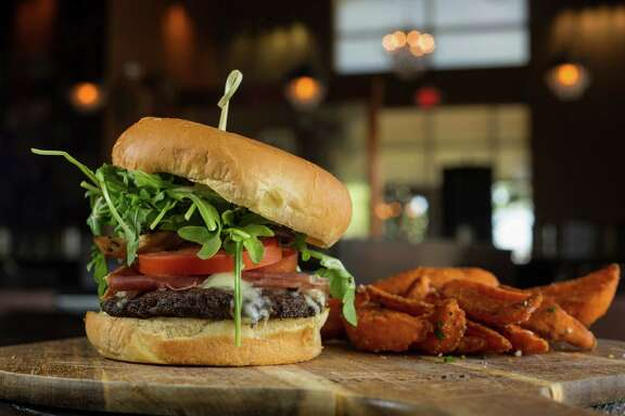 The Di Frabo burger tops a well-seasoned beef patty with mozzarella, Italian cold cuts, pickles, tomato, avocado, caramelized onion spread, honey mustard and arugula.