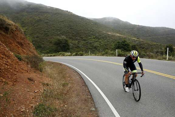 Matthew Accarrino bikes up McCullough Road during interval training in Sausalito, California, on Wednesday, July 6, 2016.