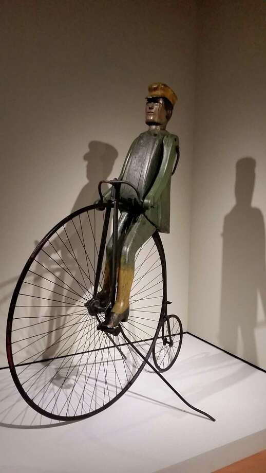 "This June 30, 2016 photo shows Amede' Thibault's laminated wood piece he built to stand above his bicycle shop and livery in St. Albans, Vt., between 1895-1905, and is on display  at the Crystal Bridges Museum of American Art in Bentonville, Ark. It is part of the exhibit ""American Made: Treasures from the American Folk Art Museum"" runs through mid-September. Photo: Kelly P. Kissel /AP / Copyright 2016 The Associated Press. All rights reserved. This material may not be published, broadcast, rewritten or redistribu"