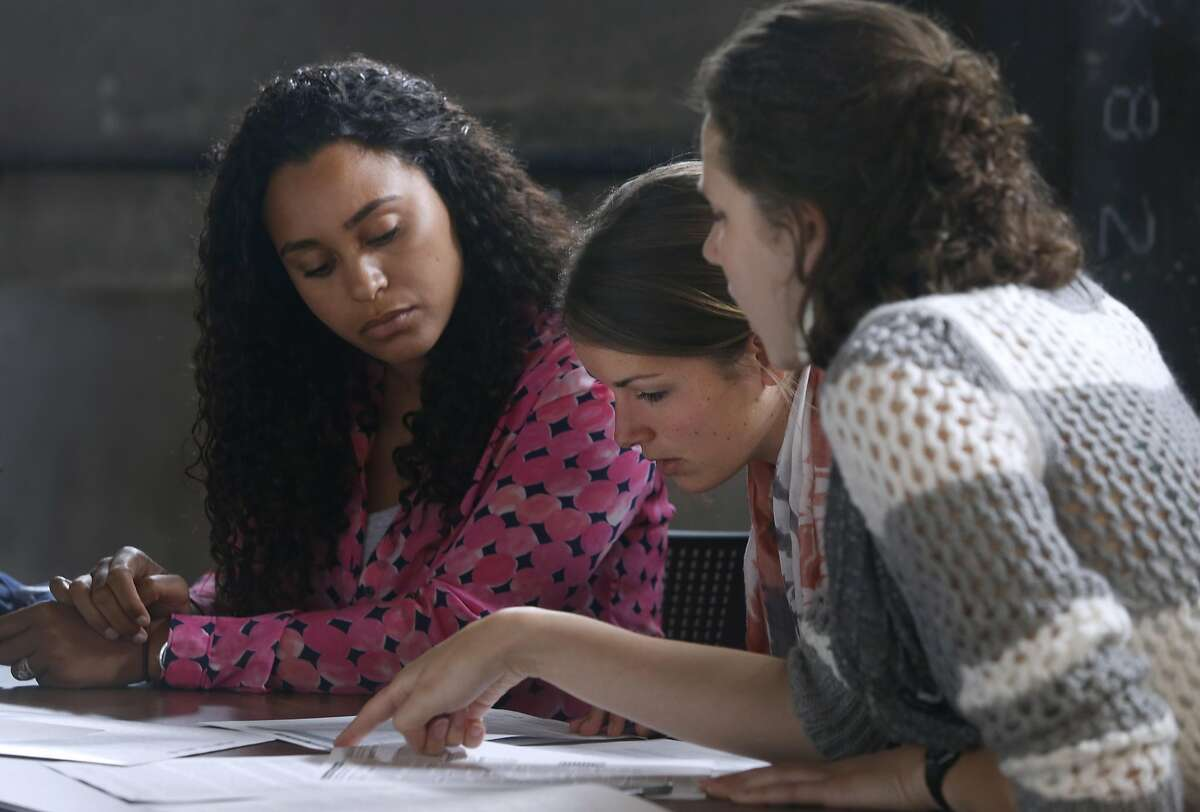 From left, Hannah Santos, Lindsay Eckert and Audrey McMillion study student application forms to learn how parents navigate through the public school system, while they train for special education teaching positions through Teach for America in San Francisco, Calif. on Thursday, July 7, 2016.