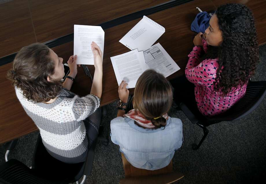 From left, Audrey McMillion, Lindsay Eckert and Hannah Santos study student application forms to learn how parents navigate through the public school system, while they train for special education teaching positions through Teach for America in San Francisco, Calif. on Thursday, July 7, 2016. Photo: Paul Chinn, The Chronicle