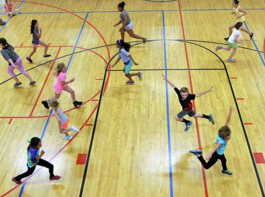 Sixty local children from the Capital District and Saratoga Regional YMCAs rehearse for SPAC's The Performance Project: Youth in Motion Thursday July 7, 2016 in Saratoga Springs, NY.  (John Carl D'Annibale / Times Union) Photo: John Carl D'Annibale / 20037258A
