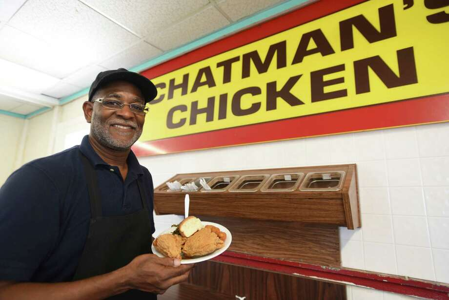 Owner Eddie Chatman of Chatman's Chicken with his restaurant's signature dish. Photo: Billy Calzada /San Antonio Express-News / San Antonio Express-News