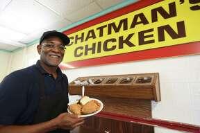 Owner Eddie Chatman of Chatman's Chicken with his restaurant's signature dish.