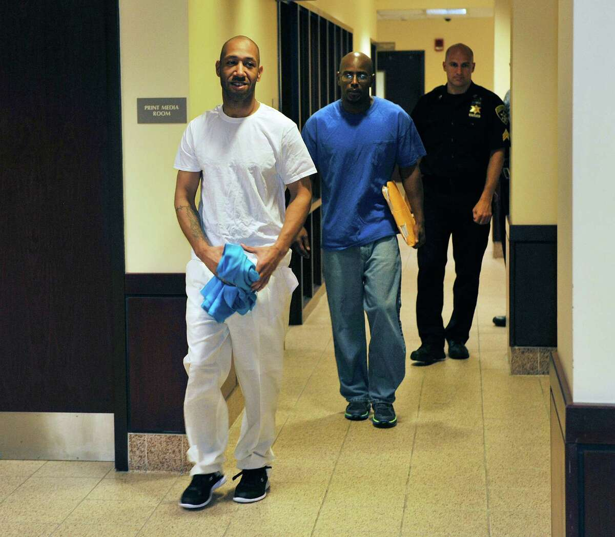 Lavell Jones, left, and Carl Dukes walk out of the Albany County Judicial Center on Thursday, July 7, 2016, in Albany, N.Y. Jones and Dukes, who was imprisoned for the 1997 killing of Erik Mitchell, a University at Albany student, were exonerated of the crime. Another man has been implicated in the killing. (Paul Buckowski / Times Union)