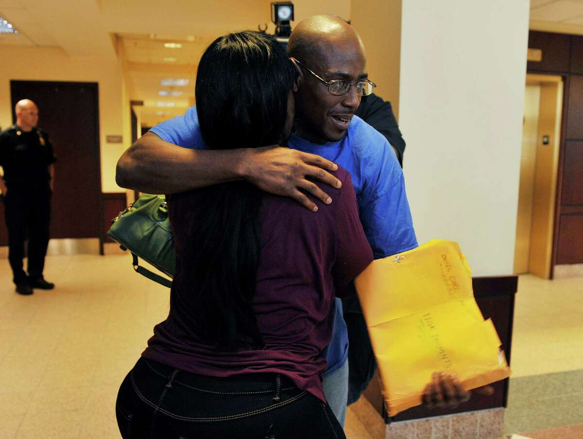 Carl Dukes hugs his sister, Tyhisha Dukes at the Albany County Judicial Center on Thursday, July 7, 2016, in Albany, N.Y. Dukes, who was imprisoned for the 1997 killing of Erik Mitchell, a University at Albany student, was exonerated of the crime. Another man has been implicated in the killing. (Paul Buckowski / Times Union)
