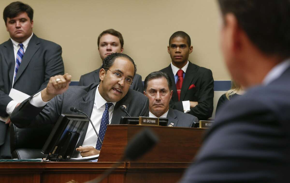 House Oversight and Government Reform Committee member Rep. Will Hurd, R-Texas, joined at right by Rep. Gary Palmer, R-Ala., questions FBI Director James Comey as he testifies on Capitol Hill in Washington, Thursday, July 7, 2016, before the committee's hearing to explain his agency's recommendation to not prosecute Democratic presidential candidate Hillary Clinton over her private email setup during her time as secretary of state. (AP Photo/J. Scott Applewhite)