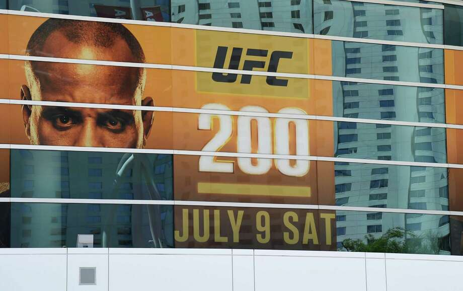 A banner for UFC 200 at T-Mobile Arena shows half of an image of mixed martial artist Daniel Cormier and a blank space where an image of mixed martial artist Jon Jones had been displayed on July 7, 2016 in Las Vegas. On July 6, Jones was pulled from his light heavyweight title fight against Cormier due to a potential violation of the UFC's anti-doping policy. Photo: Ethan Miller /Getty Images / 2016 Getty Images