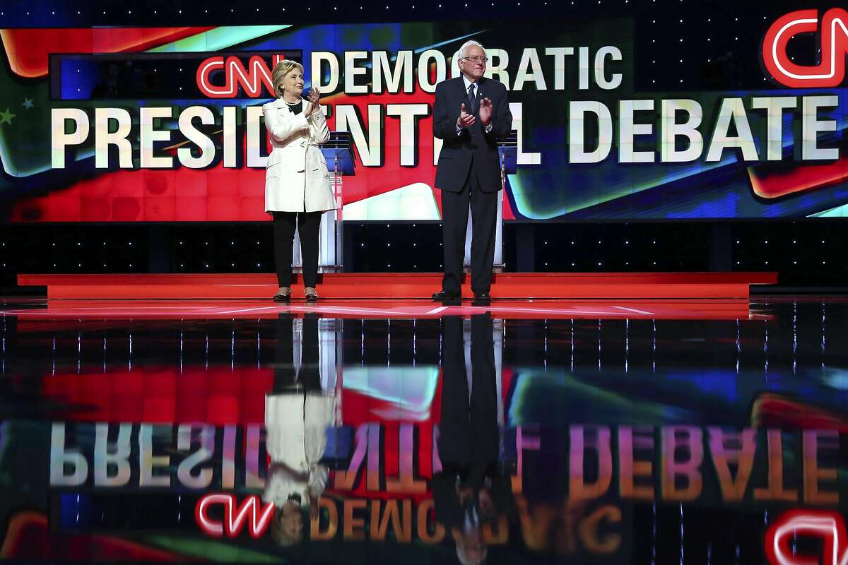 FILE � Hillary Clinton and Sen. Bernie Sanders before the start of what would be the final Democratic presidential debate, at the Brooklyn Navy Yard in New York, April 14, 2016. After three weeks of private preparations, Sanders is expected to endorse Clinton July 12 at a campaign event in New Hampshire, according to three Democrats who have been involved in the planning. (Chang W. Lee/The New York Times)