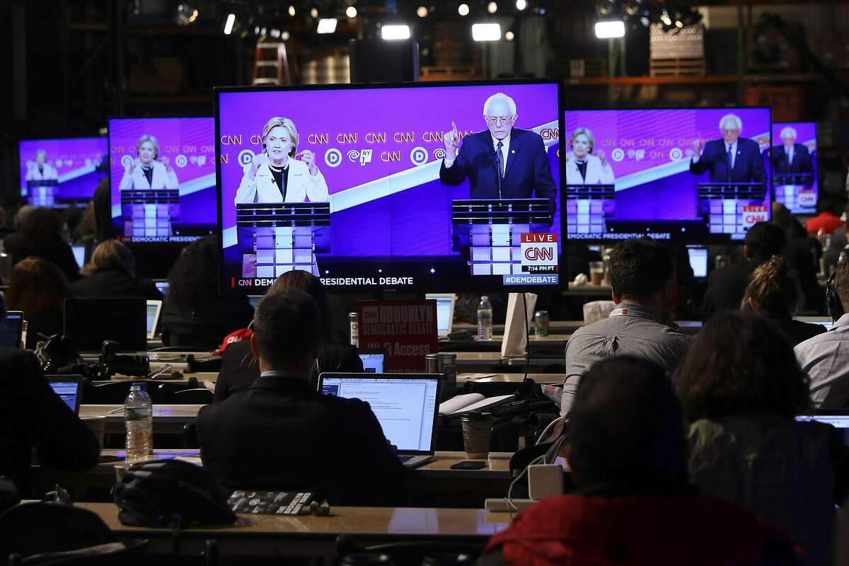 FILE � Journalists work as Hillary Clinton and Sen. Bernie Sanders take part in what would be the final Democratic presidential debate, at the Brooklyn Navy Yard in New York, April 14, 2016. After three weeks of private preparations, Sanders is expected to endorse Clinton July 12 at a campaign event in New Hampshire, according to three Democrats who have been involved in the planning. (Chang W. Lee/The New York Times)