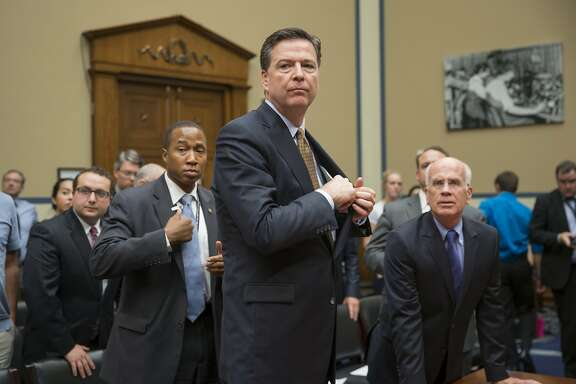 FBI Director James Comey concludes his appearance before the House Oversight and Government Reform Committee, on Capitol Hill in Washington, Thursday, July 7, 2016, to explain his agency's recommendation to not prosecute Democratic presidential candidate Hillary Clinton over her private email setup during her time as secretary of state. At right is committee member Rep. Peter Welch, D-Vt. (AP Photo/J. Scott Applewhite)