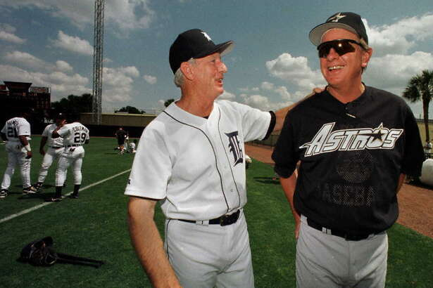 LAKELAND, UNITED STATES: Detroit Tigers guest instructor and Hall Of Fame member Al Kaline (L) and Houston Astros Manager Larry Dierker get together before their spring training game at Marchant Stadium in Lakeland, Florida 19 March. AFP PHOTO/CARLO ALLEGRI (Photo credit should read CARLO ALLEGRI/AFP/Getty Images)